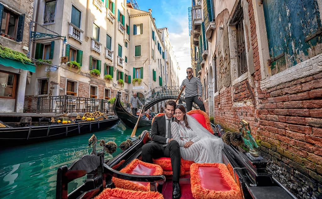 Couple in a gondola at Venice Canal, Italy